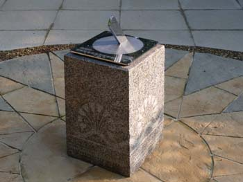 stainless sundial showing clear reflections in the polished surface