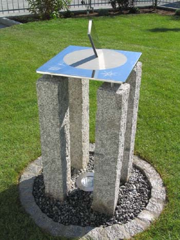 Staainless sundial on a four-legged plinth